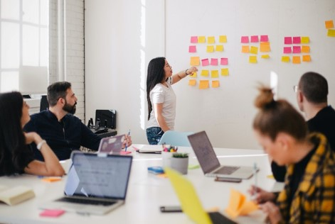 a teambuilding exercise to brainstorms solutions with sticky notes—action-strategies-by-design